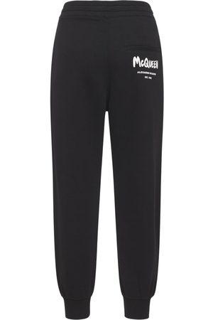 Alexander McQueen Women Trousers - Cotton Jersey Logo Graffiti Jogger Pants