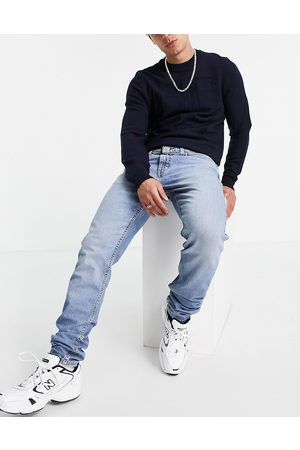 Levi's 512 slim tapered fit lo-ball jeans in mid wash