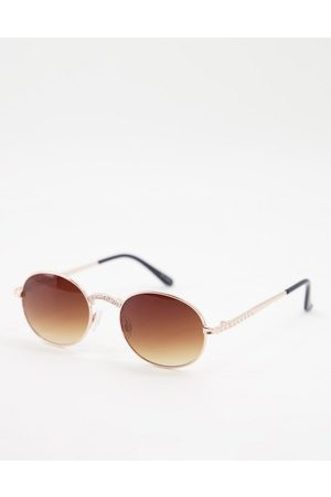Jeepers Peepers Women Sunglasses - Womens round sunglasses with nose and arm detail in