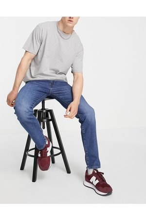 Levi's 502 tapered fit jeans in mid wash