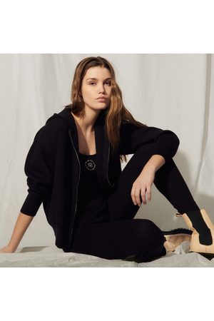 Sandro Zipped hoodie with an embroidered back