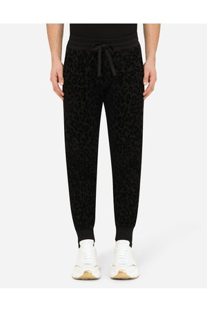 Dolce & Gabbana Men Trousers - Trousers and Shorts - Jogging pants with flocked leopard print male 48