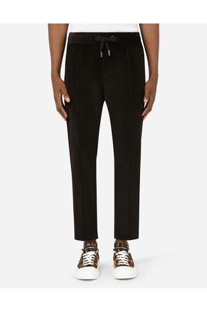 Dolce & Gabbana Men Trousers - Trousers and Shorts - Cotton jogging pants with branded plate male 44