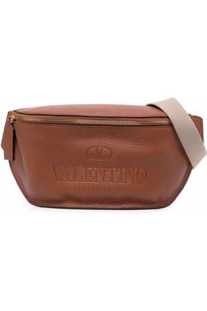 VALENTINO GARAVANI Embossed-logo belt bag