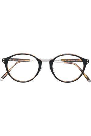 Retrosuperfuture Tortoiseshell-effect round glasses