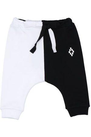 MARCELO BURLON BOTTOMWEAR - Trousers