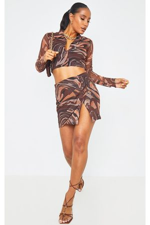PRETTYLITTLETHING Marble Print Mesh Button Mini Skirt