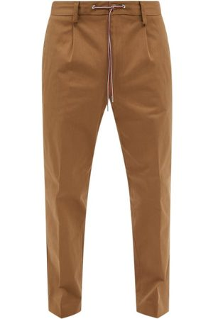 Moncler Pleated Cotton-blend Twill Trousers - Mens
