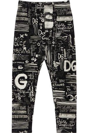Dolce & Gabbana All Over Logo Print Interlock Leggings