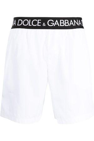 Dolce & Gabbana Men Swim Shorts - Logo-tape slip-on swim shorts