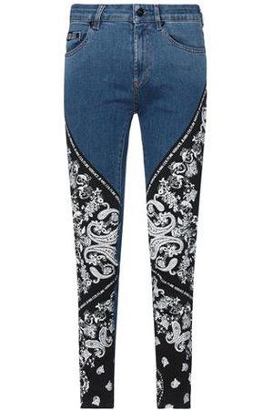 VERSACE Men Trousers - BOTTOMWEAR - Denim trousers