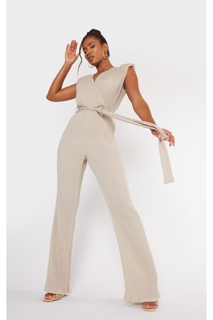 PRETTYLITTLETHING Women Jumpsuits - Stone Pleated Shoulder Pad Flared Leg Jumpsuit