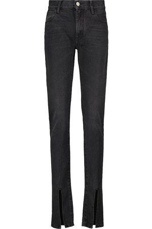 The Attico High-rise slim split-hem jeans