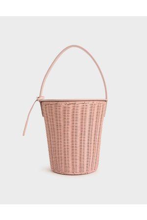 CHARLES & KEITH Rattan Cylindrical Top Handle Bag