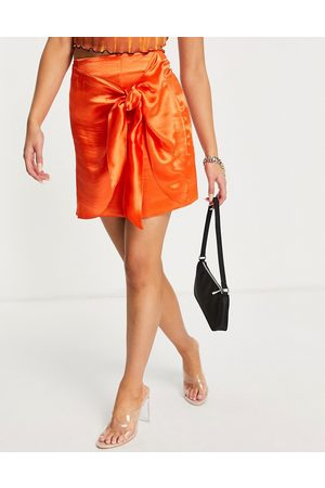 ASOS Satin mini skirt with knot detail in fire red