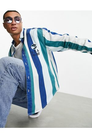 ASOS 90s oversized collegiate stripe twill shirt with basketball embroidery