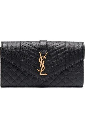 Saint Laurent Large flap wallet in grain de poudre embossed leather