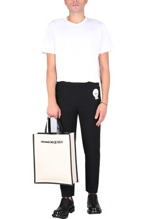 McQ Alexander McQueen JOGGING PANTS WITH EMBROIDERED SKULL