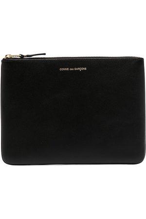 Comme des Garçons Engraved-logo leather tablet pouch