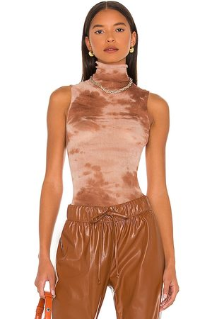 ENZA COSTA Sleeveless Turtleneck Top in . Size XS, S, M.