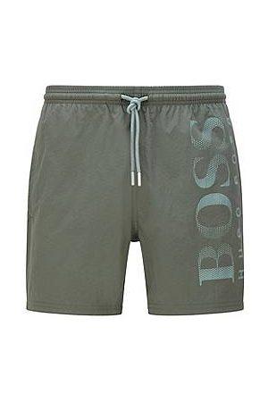 HUGO BOSS Men Swim Shorts - Logo-print swim shorts in technical fabric