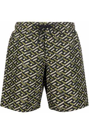 VERSACE Men Swim Shorts - Greca logo-print swim shorts