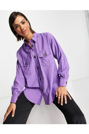 ASOS DESIGN Women Blouses - Viscose curved hem shirt with pockets and horn buttons in