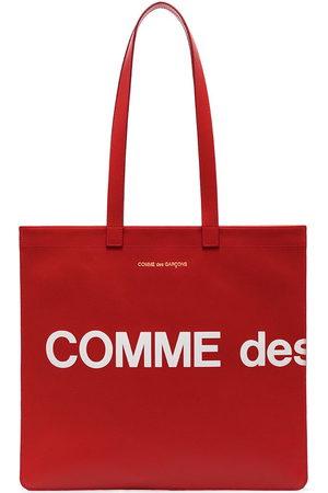 Comme des Garçons Women Handbags - Logo print tote bag