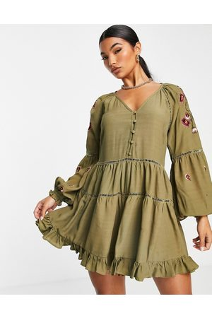 ASOS Lace trim and embroidered playsuit in khaki-Multi