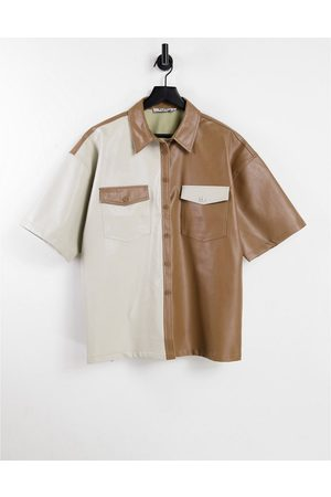 NA-KD Oversized block faux leather shirt in -Neutral