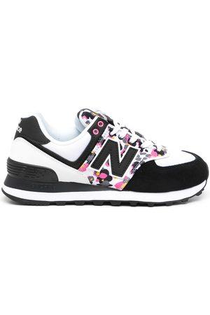 New Balance 574 animal print sneakers